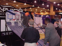 Double shot or Pop A Shot basketball rentals. This is a picture of our pop a shot rental in a trade show booth for a trade show traffic builder.