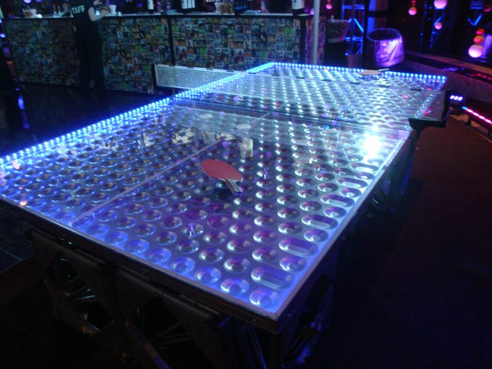 Ping Pong With A Night Life Look. Our LED Ping Pong Table Can Be Integrated  With A DMX Controller, Flash Or Just Stay Lit.