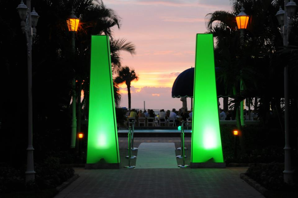 Green Spandex Truss Towers for your next event decor lighting rental in Orlando, Miami, Las Vegas