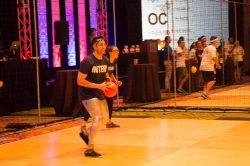 Guest throwing dodgeballs in our dodgeball court rental that was done in Orlando Fl for a corporate event client.