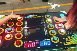 Catch The Light Game Rental Florida with two young women testing out the arcade game in our warehouse.